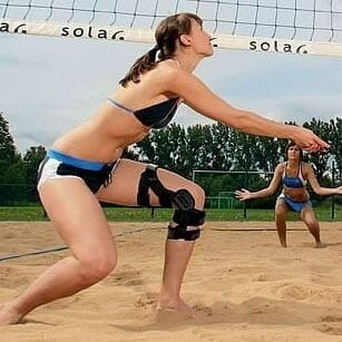 beach volleyball with DonJoy ACL Brace